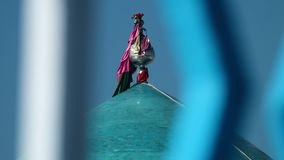 A flag on a roof ornament. A racking focus, extreme close up of the flag of Afghanistan on a roof ornament stock video
