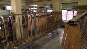 Racks with aircraft parts. Airplane details in workshop stock footage