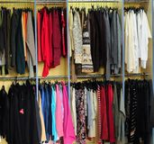 Racks with clothes royalty free stock photos