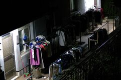Racks of clothes outdoors Royalty Free Stock Images