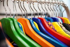Racks with hanging clothes. Stock Photo