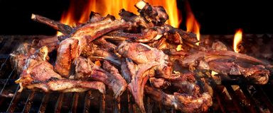 Racks Of Lamb On The Hot Flaming BBQ Grill stock photo