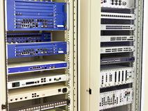 Racks with network switches and routers Royalty Free Stock Images