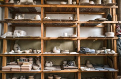 Racks in a pottery workshop in which there are potter Royalty Free Stock Photos