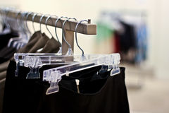 Racks of skirts hanging in a store Stock Photos