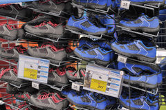 Racks with Sneakers at the sports store Stock Image