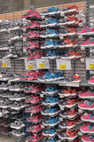 Racks with Sneakers at the sports store Stock Photography