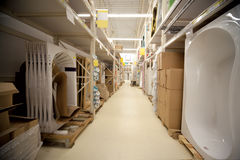 Racks in warehouse sanitary technicians in store Stock Photography