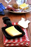 Cheese in a raclette pan royalty free stock photos