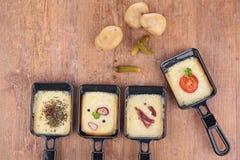 Raclette-Behälter Stockbilder