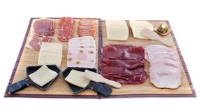 Raclette cheese and meat Royalty Free Stock Photo