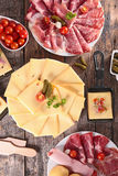 Raclette cheese and meats Stock Photos