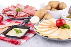 Raclette cheese and meats Royalty Free Stock Photo