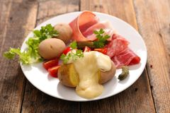 Raclette cheese stock images