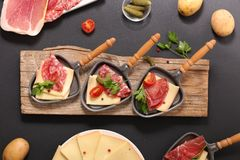 Raclette cheese with salami. Top view stock photo