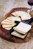 Raclette cheese and wineglass Royalty Free Stock Images