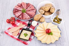 Raclette and meats Royalty Free Stock Photo