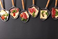 Raclette ost Arkivbilder