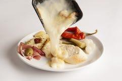 Raclette ost på en platta Royaltyfria Foton