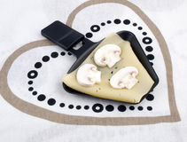 Raclette pan with cheese and mushroom - party food Royalty Free Stock Image