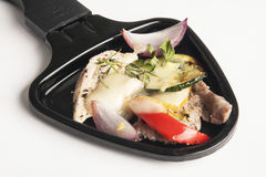 Raclette pan with various vegetables. And meat Royalty Free Stock Images