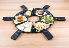 Raclette pans with food, ideal for party Royalty Free Stock Image