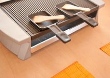 Raclette preparation Stock Image