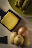 Raclette trays with chessee Stock Photos