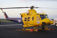 RACQ Bell 412 helicopter. MACKAY, QUEENSLAND - APR 17, 2006: RACQ roadside assistance Bell 412 helicopter on the tarmac of Mackay airport Royalty Free Stock Photo