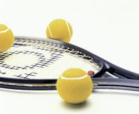 Racquet and balls. Racquet and yellow tennis balls Stock Photos