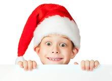 rad圣诞老人帽子的滑稽的男孩 免版税库存图片