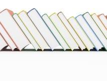 Rad av böcker på vit Royaltyfria Foton