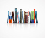 Rad av böcker på vit bakgrund Arkivbilder