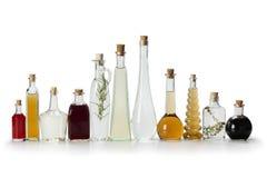 Rad av flaskor med vinäger Royaltyfri Bild