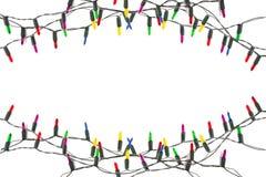 Rad av garnering för julljus som isoleras på den vita backgrouen royaltyfri bild