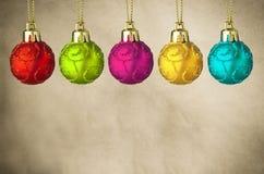 Rad av julstruntsaker på pergament Royaltyfri Fotografi