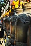 Rad av klockor i tempel Royaltyfri Bild