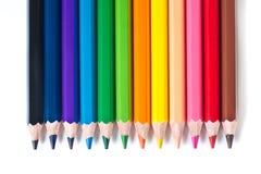 Rad av kulöra blyertspennor Royaltyfri Fotografi