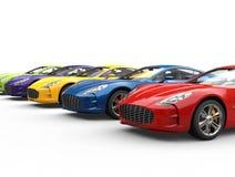 Rad av moderna färgrika sportbilar Fotografering för Bildbyråer