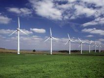 Rad av sju vindturbiner Royaltyfria Foton