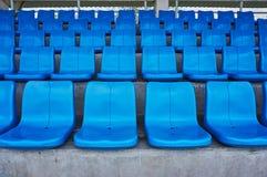Rad av stolar i arena Royaltyfria Foton