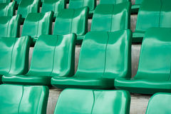 Rad av stolar i arena Arkivfoton
