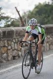 Rad cycling woman. Beautiful woman on race road cycling downhill Royalty Free Stock Image