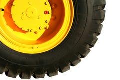 Rad des schweren Gebäudebulldozers der gelben Farbe lizenzfreies stockbild