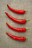 rad för fyra peppar Royaltyfria Foton