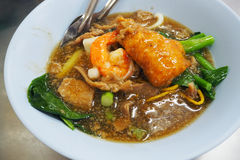 Rad Na or stirred fried noodle with pork and shrimp Stock Photos