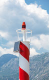 Rad and white striped lighthouse Royalty Free Stock Photos