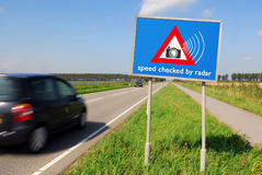 Radar 1. Speed checked by radar roadsign in rural landscape and speeding car with motion blur Stock Image