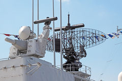 Radar. Antenna of the radar on the deck of a modern military ship Stock Photography