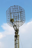 Radar. The antenna of the radar on the background of blue sky with white clouds Royalty Free Stock Photography
